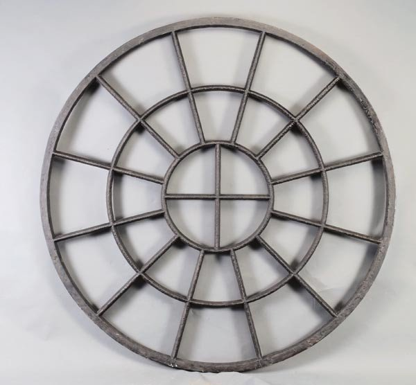 8: A pair of George III circular cast iron window fra