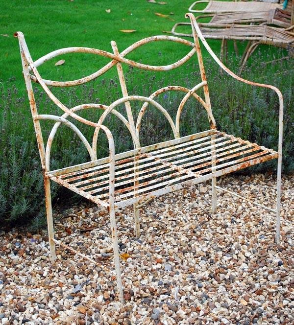9: A painted wrought iron garden seat in the Regency
