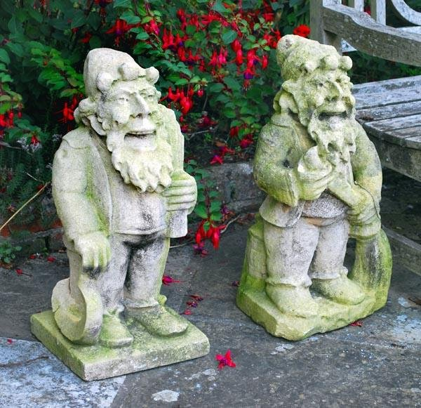 11: A pair of sculpted stone models of dwarves, circa