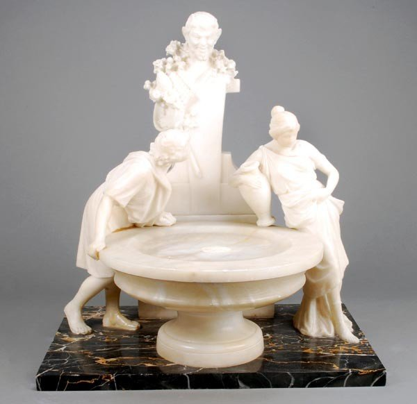 14: An Italian sculpted alabaster and marmo portoro mo