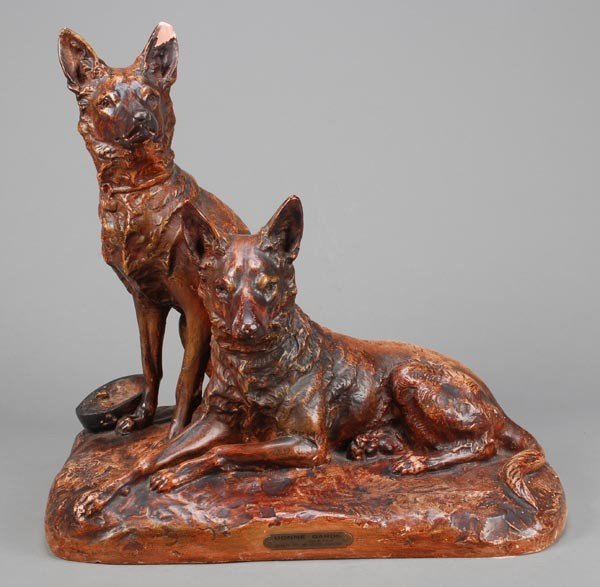 15: A French painted plaster group of two German Sheph
