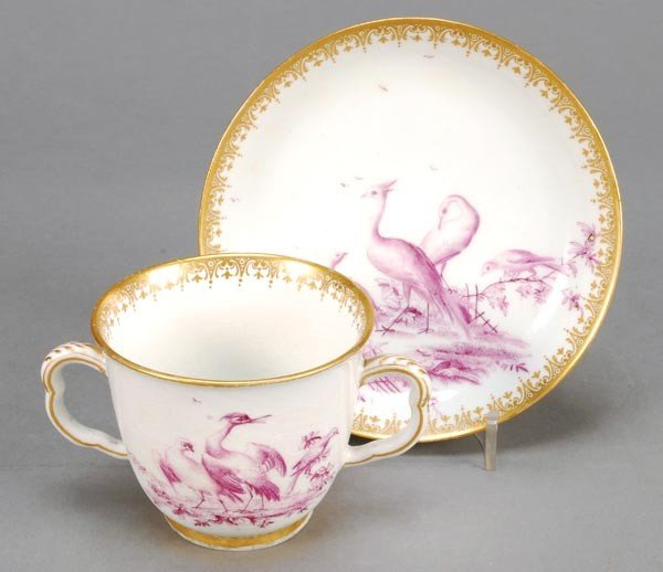9: A Chelsea chocolate cup and saucer, painted in puc