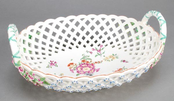 15: A Chelsea pierced oval twin-handled basket, the ex