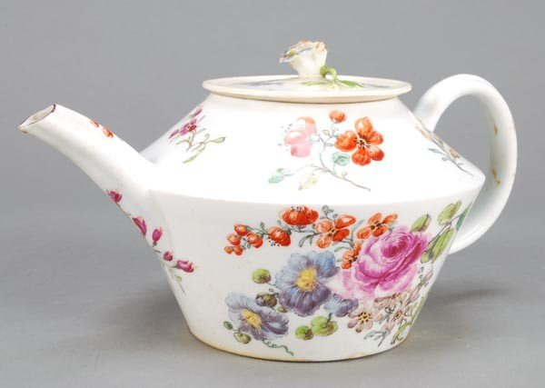 16: A Chelsea polychrome teapot and cover, of tapered