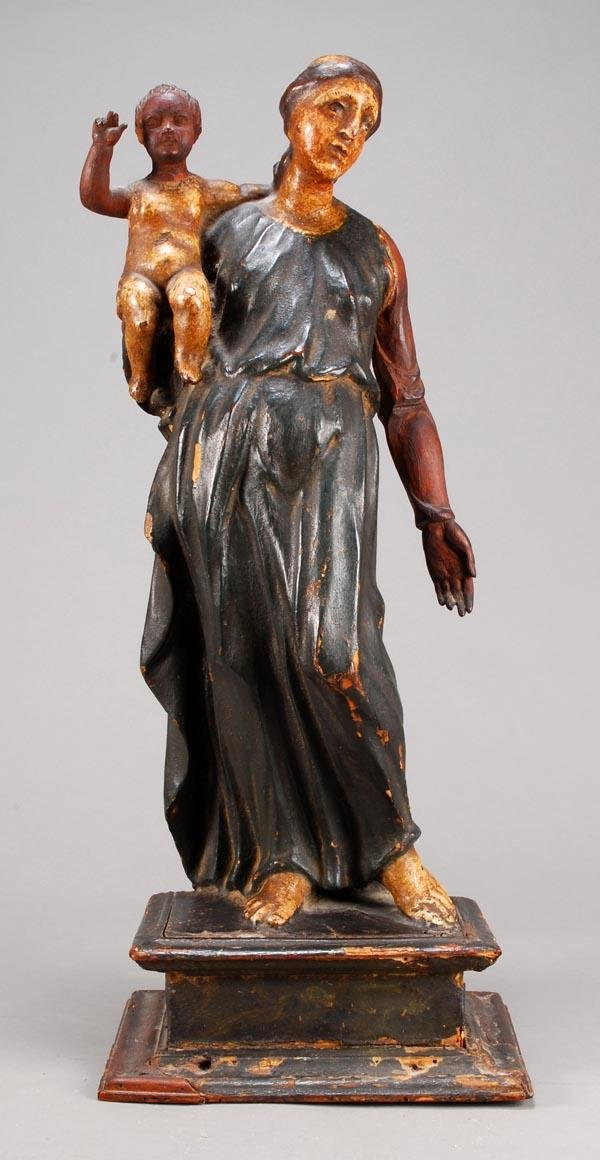 4: A Continental polychrome painted and carved wood g