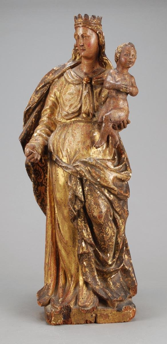 5: A Continental carved, painted and parcel gilt pine