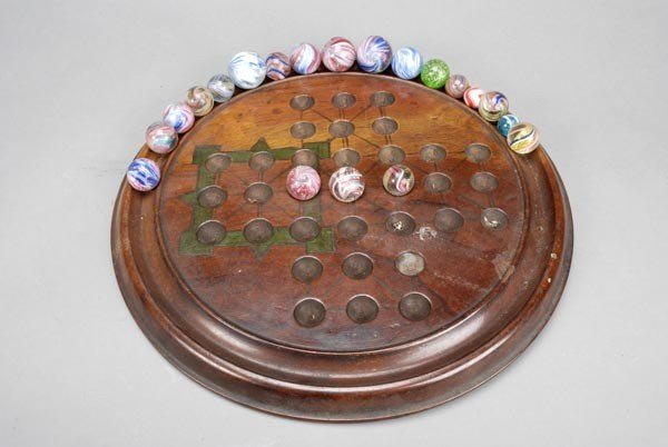 9: A collection of approximately thirty-five marbles