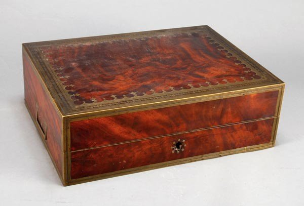 11: A George III mahogany and cut brass travelling toi