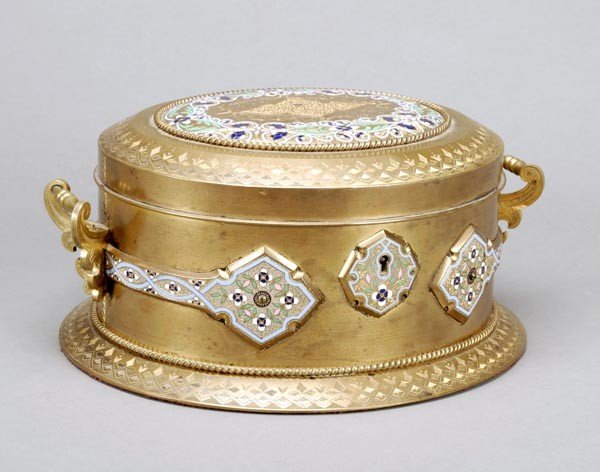 12: A French gilt metal and champleve enamelled oval c