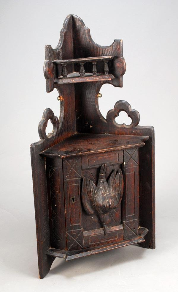 13: A Black Forest carved and stained oak hanging corn