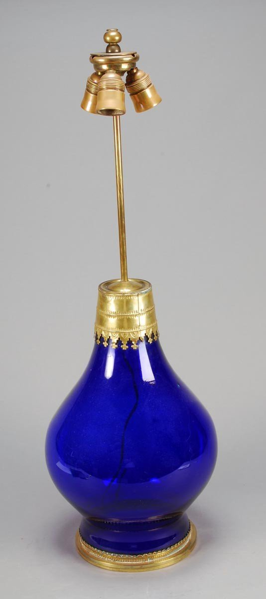 17: A blue glass and polished brass mounted table lamp
