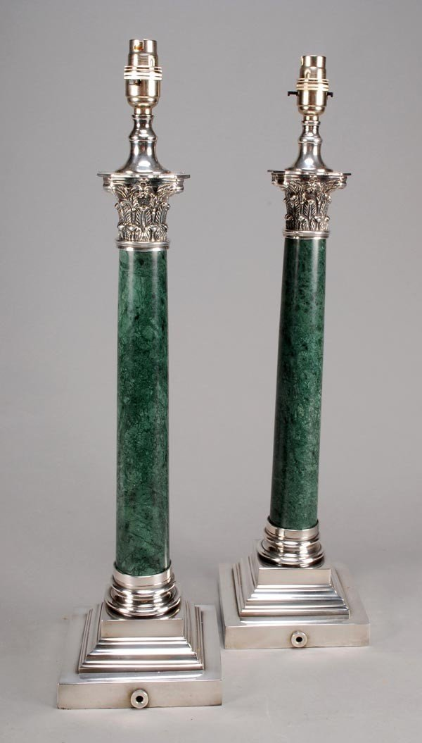19: A pair of silver plated metal mounted green serpen