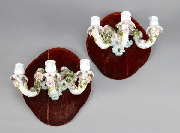 21: A pair of Continental porcelain three light wall a