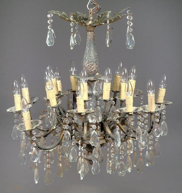 25: A Continental cut glass hung gilt metal sixteen li