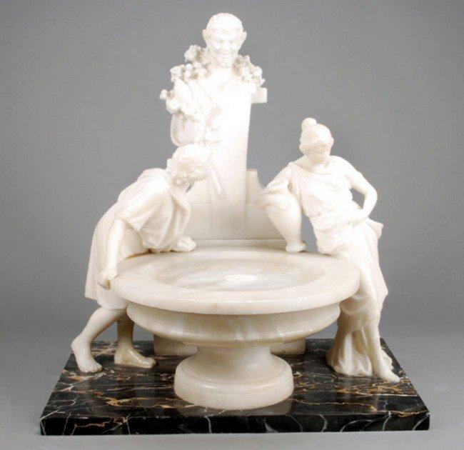 8: An Italian sculpted alabaster and marmo portoro mo