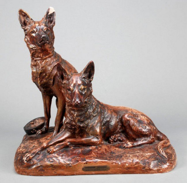 9: A French painted plaster group of two German Sheph