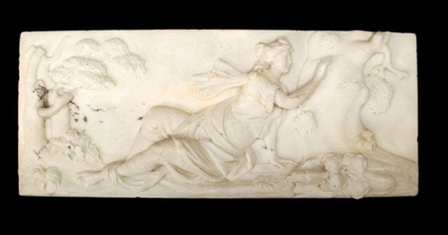 11: A sculpted white marble panel, possibly a chimneyp