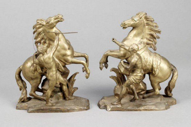 14: A pair of gilt bronze models of the Marly horses,
