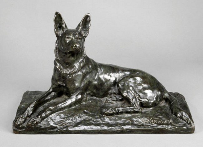 15: A French patinated bronze model of a recumbent Ger