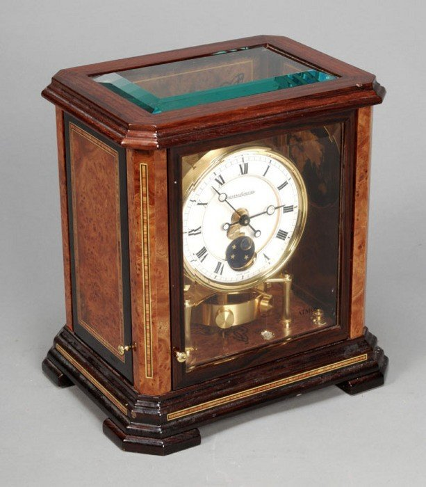 110: *A rosewood and amboyna 'Atmos' timepiece with moo