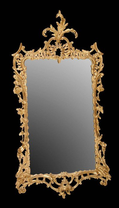 195: A carved giltwood wall mirror in George III style