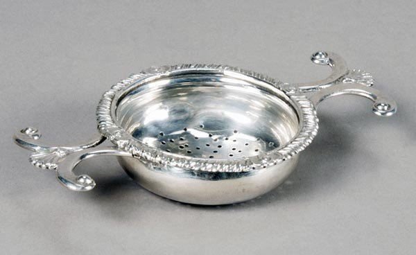 8: A George IV Scottish silver lemon strainer, no mak