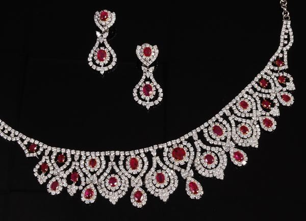 467: A ruby and diamond necklace and earring suite by D