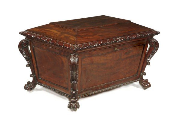 1: A mahogany sarcophagus shaped wine cooler, in earl