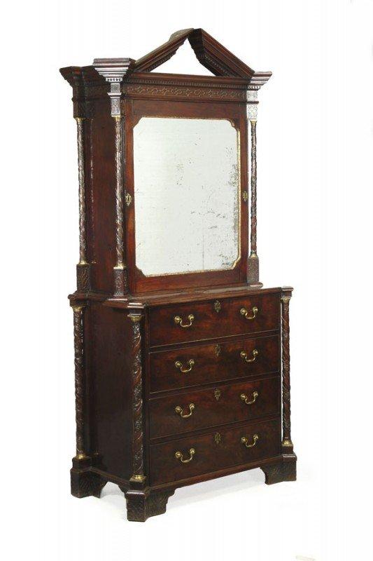 4: A mahogany, parcel gilt and fret carved secretaire