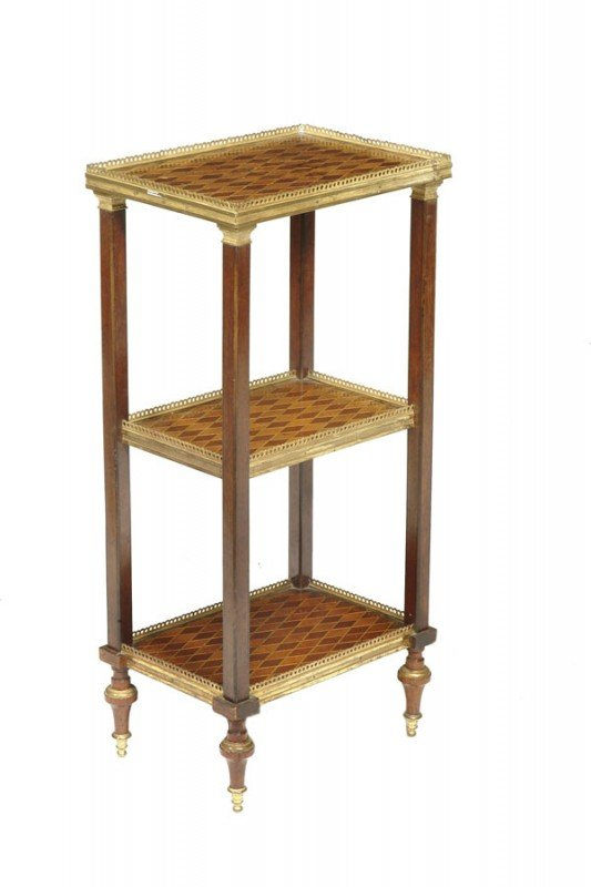 15: A mahogany and parquetry étagère, in late 18th cen