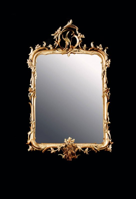 16: A giltwood and painted mirror, in 18th century Ita