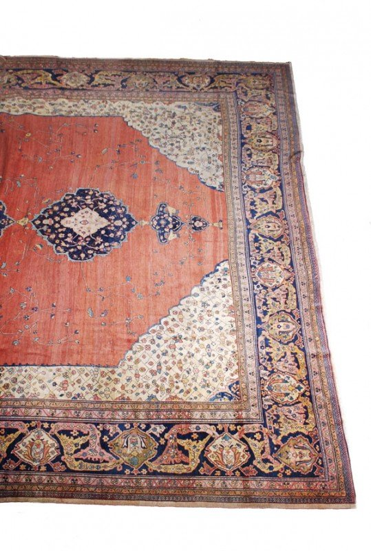 20: A Sarouk carpet, with three medallions and floral