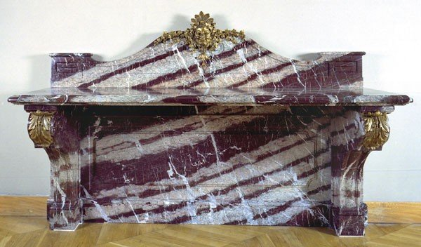 23: A carved ribboned campana marble and ormolu mounte