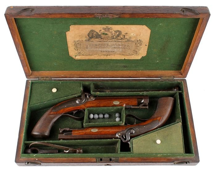 23: A Cased Pair of Percussion Travelling Pistols Sign