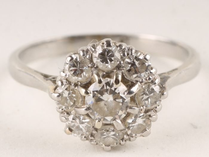 2: A nine stone diamond cluster ring, stamped 'Plat'