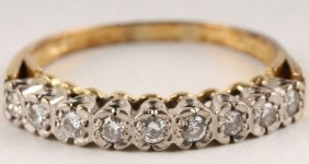 3: A nine stone diamond half hoop 18 carat gold ring