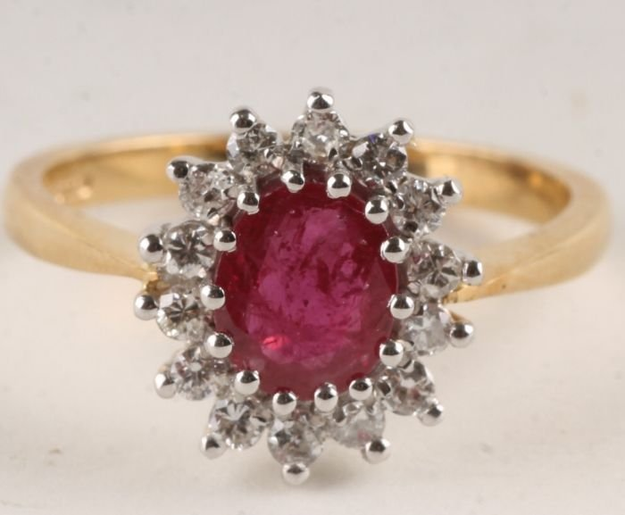 4: A ruby and diamond 18 carat gold cluster ring, Lon