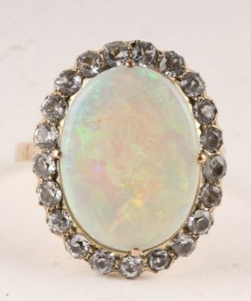 5: An opal and white sapphire cluster ring, the large