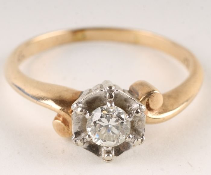 6: A diamond single stone ring, stamped '14K', the br
