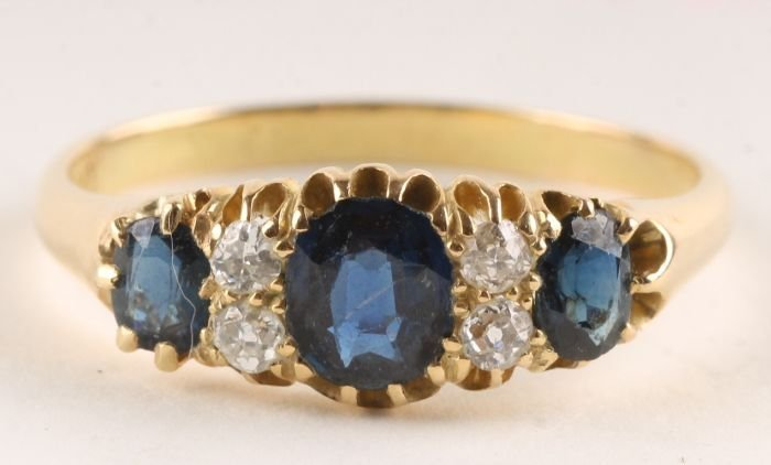 8: A sapphire and diamond ring, stamped '18ct', circa