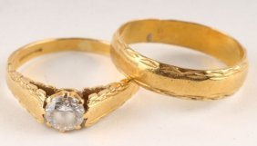 11: A single stone 22 carat gold dress ring, with engr