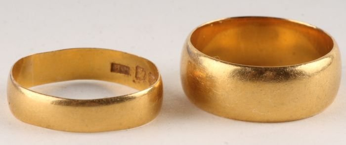 12: A 22 carat gold wedding ring, of shallow D section