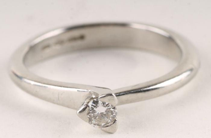 13: A diamond single stone platinum ring, the brillian
