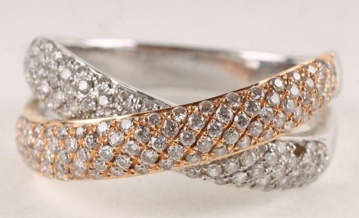 14: A diamond 18 carat two colour gold dress ring, des