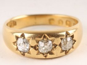 16: A three stone diamond ring, hallmarked but partial