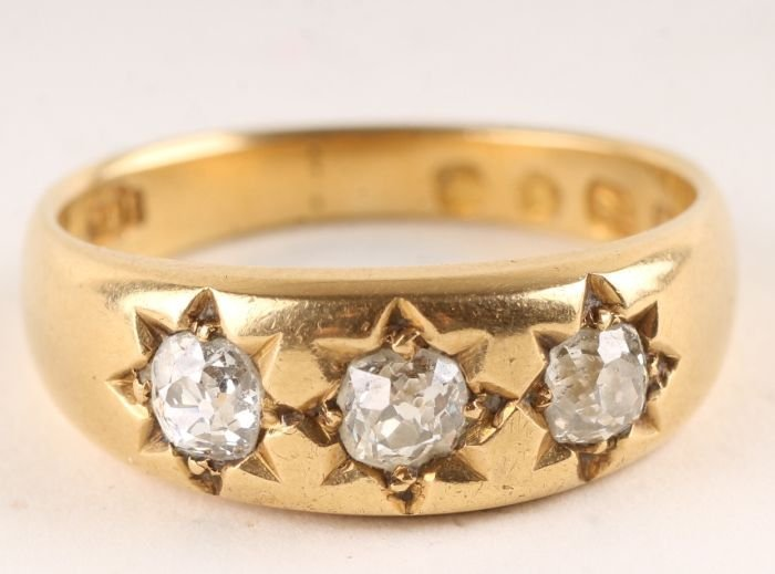 16: A three stone diamond ring, hallmarked but partial