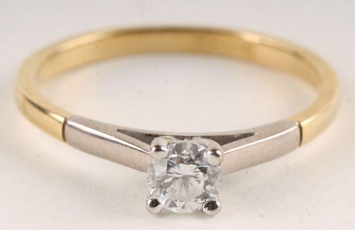 17: A diamond single stone ring, unmarked, the brillia