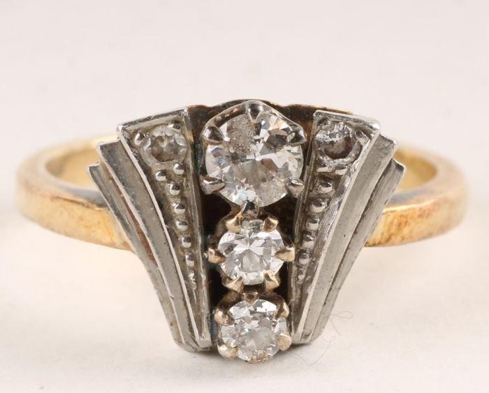 18: An Art Deco five stone diamond ring, stamped 'Plat