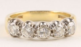 19: A five stone diamond 18 carat gold half hoop ring