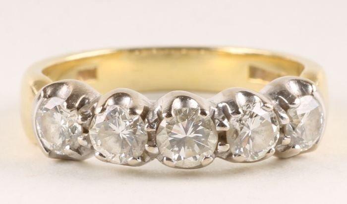19: A five stone diamond 18 carat gold half hoop ring